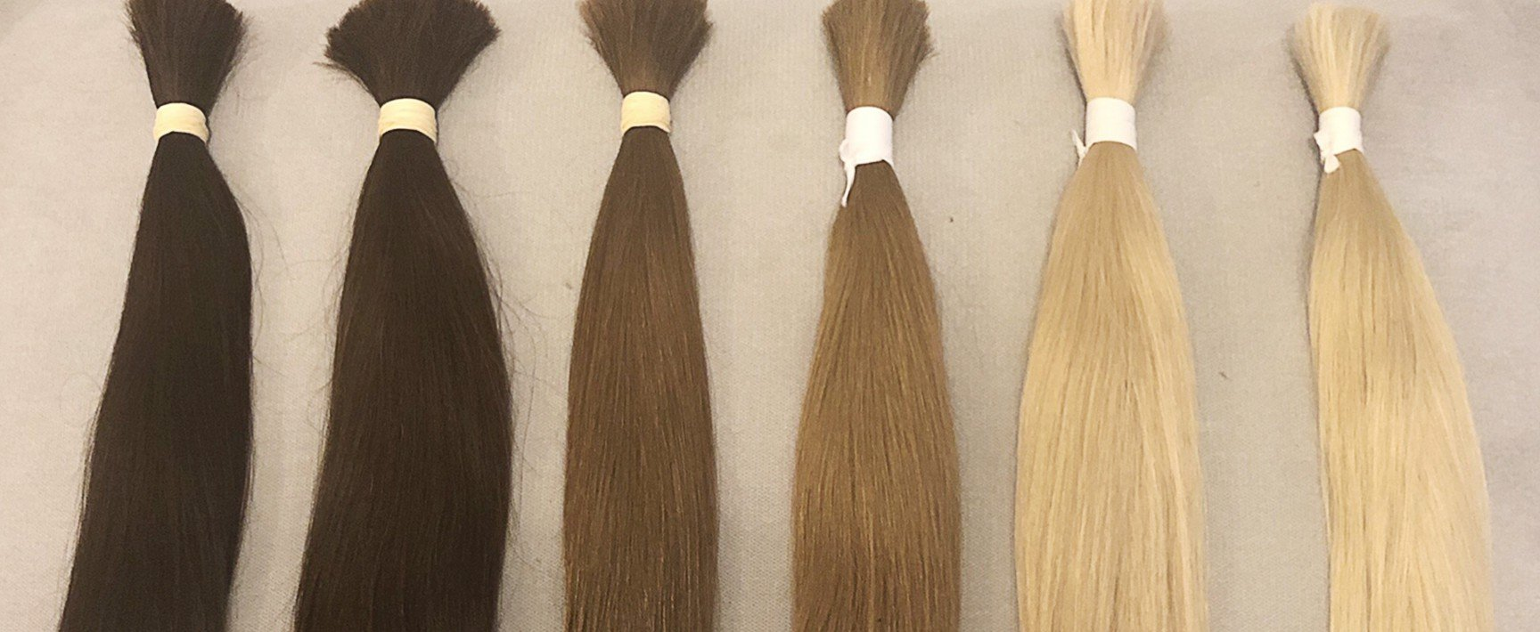 Selection of six colour bundles of hair
